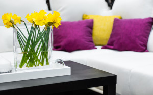 Sofa with fresh flowers - cropped